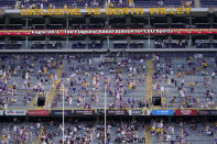 A limited number of fans, seated according to COVID-19 restrictions requiring social distancing and masks, watch in the first half an NCAA college football game between LSU and Mississippi State in Baton Rouge, La., Saturday, Sept. 26, 2020. Mississippi State won 44-34. (AP Photo/Gerald Herbert)