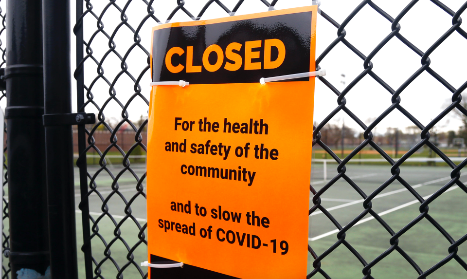 The tennis court at the Rev. Dr. Martin Luther King Jr. Park in Minneapolis remains closed and locked due to the COVID-19 pandemic. Wednesday, April 29, 2020. Some Minnesota recreation restrictions have been lifted, including golf which requires social distancing. (AP Photo/Jim Mone)