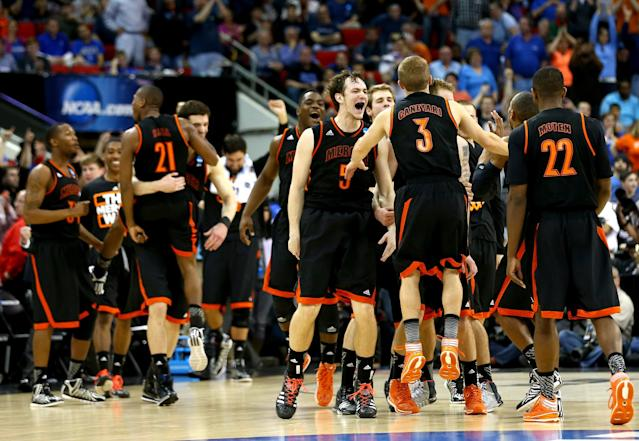 RALEIGH, NC - MARCH 21: The Mercer Bears celebrate after defeating the Duke Blue Devils 78-71 during the Second Round of the 2014 NCAA Basketball Tournament at PNC Arena on March 21, 2014 in Raleigh, North Carolina. (Photo by Streeter Lecka/Getty Images)
