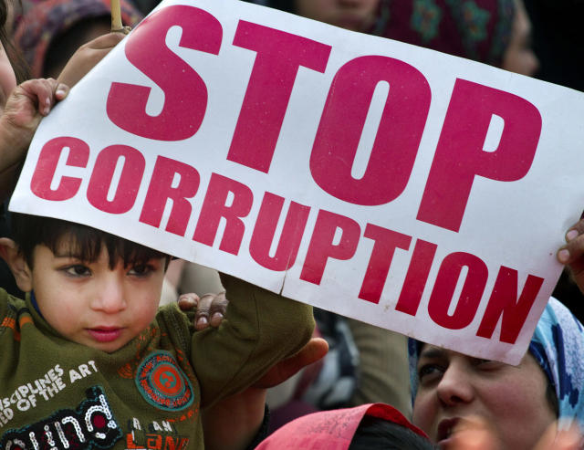 A Pakistani boy holds a placard during an anti-government rally called by Sunni Muslim cleric Tahir-ul-Qadri in Islamabad, Pakistan, Wednesday, Jan. 16, 2013. Pakistan's leaders received a powerful one-two punch Tuesday as the Supreme Court ordered the arrest of the prime minister in a corruption case and the firebrand cleric led thousands of protesters in another day of anti-government demonstrations in the capital. (AP Photo/Anjum Naveed)