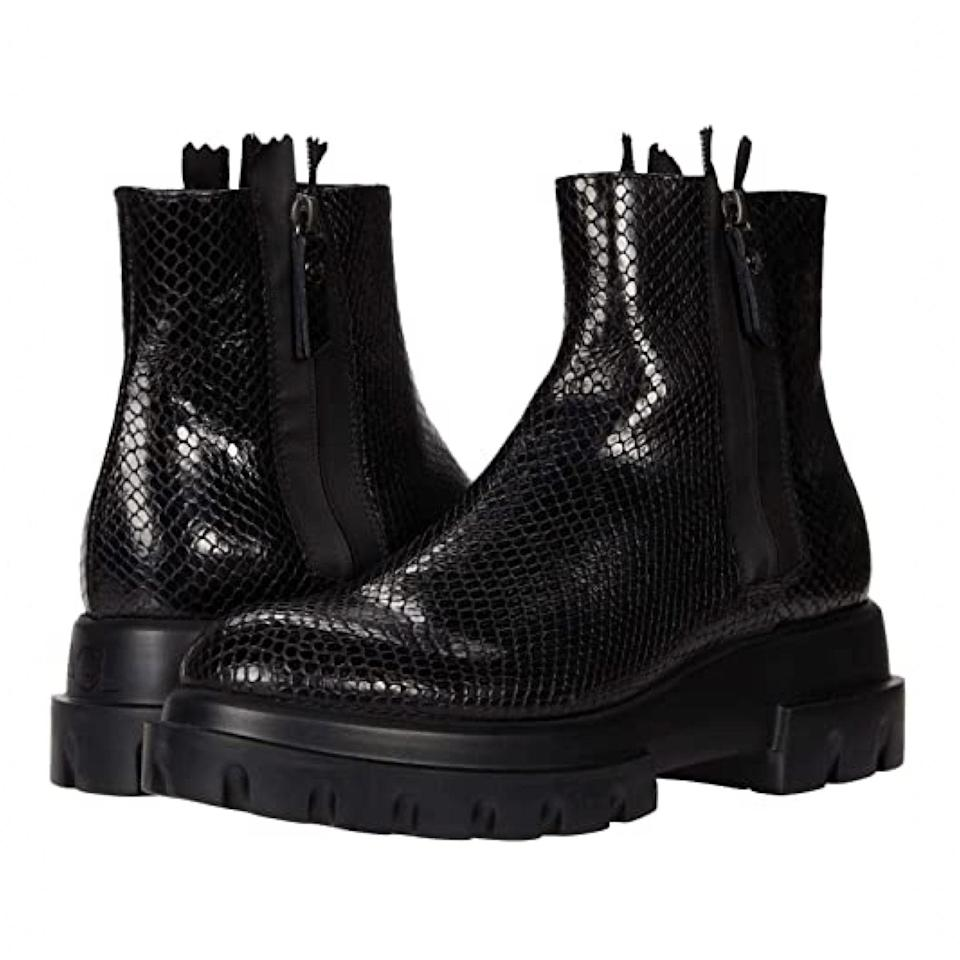 """A lower silhouette with a dose of reptilian texture for good measure. $276, Zappos. <a href=""""https://www.zappos.com/a/the-style-room/p/agl-side-zip-lug-sole-boot-black/product/9462177/color/3"""" rel=""""nofollow noopener"""" target=""""_blank"""" data-ylk=""""slk:Get it now!"""" class=""""link rapid-noclick-resp"""">Get it now!</a>"""