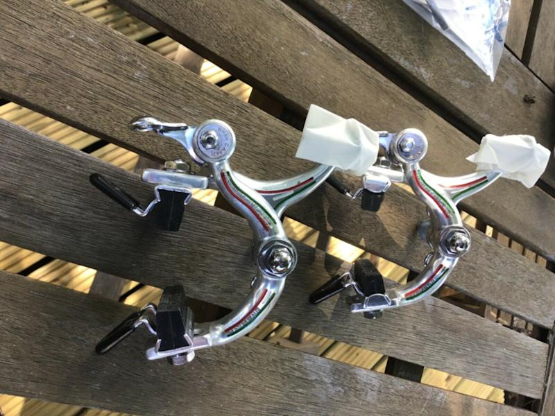 These Campagnolo Record brake callipers feature Italian tricolore detailing