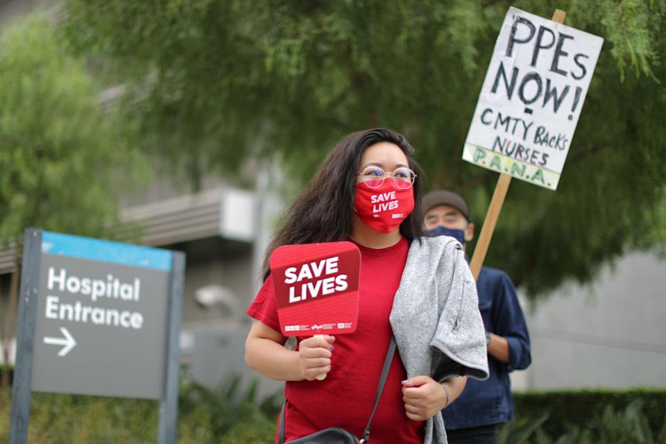 Nurses in Los Angeles participate in a national protest for personal protective equipment (PPE) and safer working practices in August as the global outbreak of COVID-19 continues. (Photo: Lucy Nicholson/Reuters)