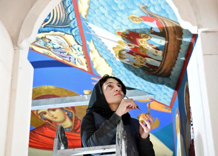 Restorer works on a fresco at the chapel of a mobile Georgian Orthodox monastery in Vlissingen