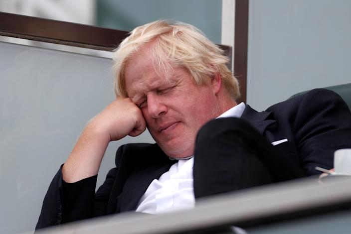 Britain's former Foreign Secretary Boris Johnson takes a nap whilst watching the England cricket team play India at The Oval cricket ground in London, Britain, September 8, 2018. REUTERS/Paul Childs