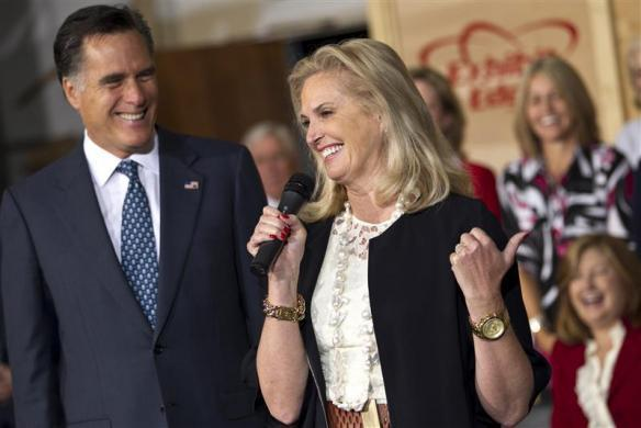 Mitt Romney smiles as his wife Ann Romney speaks during a campaign event at the Exhibit Edge building in Chantilly, Virginia May 2, 2012.