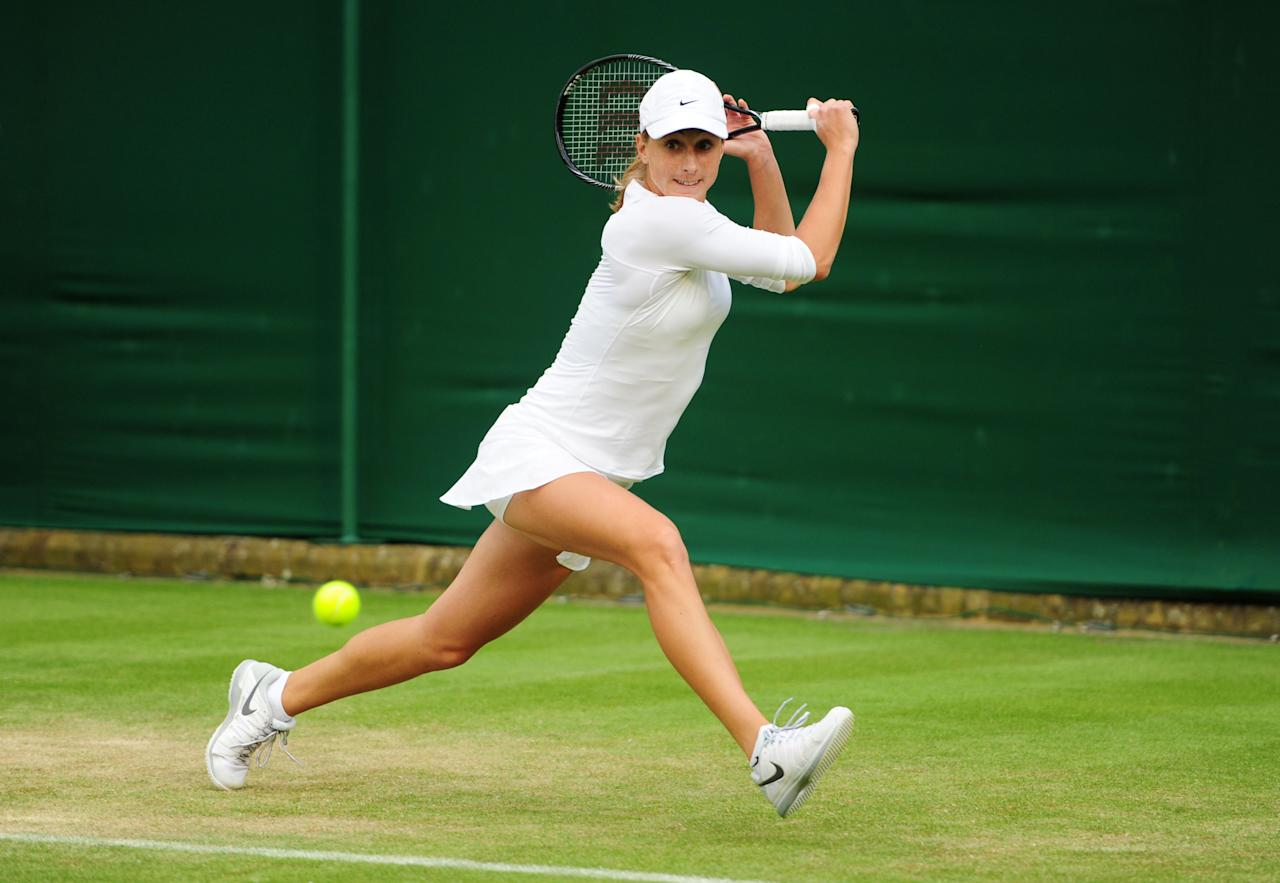 Croatia's Petra Martic in action against Georgia's Anna Tatishvili during day Two of the Wimbledon Championships at The All England Lawn Tennis and Croquet Club, Wimbledon.