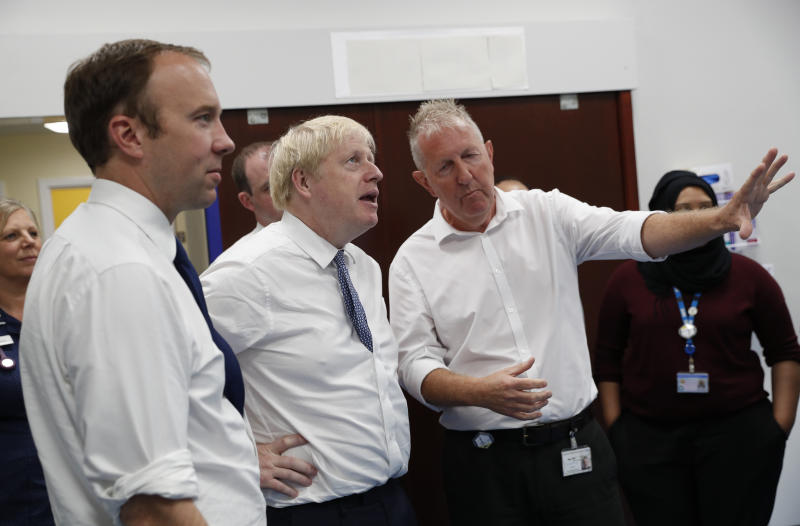 Prime Minister Boris Johnson (2nd left) and Matt Hancock, Secretary of State for Health and Social Care (left) during a visit to Pilgrim Hospital in Boston, Lincolnshire, to announce the government's NHS spending pledge of 1.8 billion.