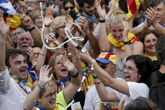 <p>People celebrate after Catalonia's parliament voted to declare independence from Spain in Barcelona on Oct. 27, 2017. (Photo: Pau Barrena/AFP/Getty Images) </p>