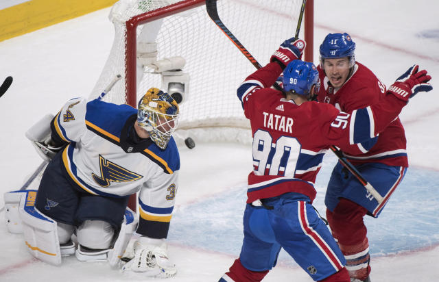 Montreal Canadiens' Brendan Gallagher (11) reacts with teammate Tomas Tatar after scoring against St. Louis Blues goaltender Jake Allen during the third period of an NHL hockey match, in Montreal, Wednesday, Oct. 17, 2018. (Graham Hughes/The Canadian Press via AP)
