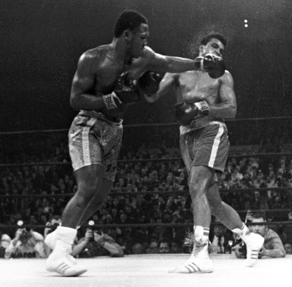 <p>Muhammad Ali takes a left from Joe Frazier during the 15th round of their heavyweight title boxing bout in New York. Frazier won a unanimous decision. Prime seats were $150 – an astonishing sum at the time – and they could have sold them for twice that price. (AP Photo)</p>