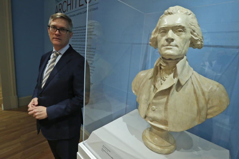 "Erik H. Neil, director of the Chrysler Museum of Art, poses next to a bust of Thomas Jefferson during a tour of an exhibit titled ""Thomas Jefferson, Architect: Palladian Models, Democratic Principles, and the Conflict of Ideals."" At the museum in Norfolk, Va., Wednesday, Oct. 16, 2019. (AP Photo/Steve Helber)"