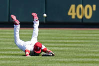 St. Louis Cardinals center fielder Lane Thomas dives but is unable to catch a double hit by Washington Nationals' Starlin Castro during the second inning of a baseball game Wednesday, April 14, 2021, in St. Louis. (AP Photo/Jeff Roberson)