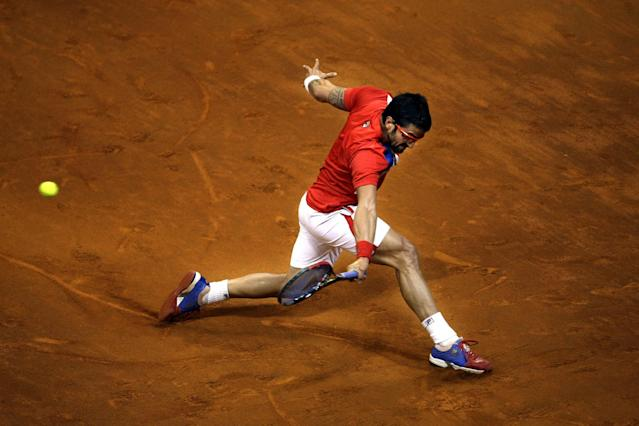 Serbia's Janko Tipsarevic returns the ball to Canada's Milos Raonic during their Davis Cup semifinals tennis match in Belgrade, Serbia, Friday, Sept. 13, 2013. (AP Photo/ Marko Drobnjakovic)