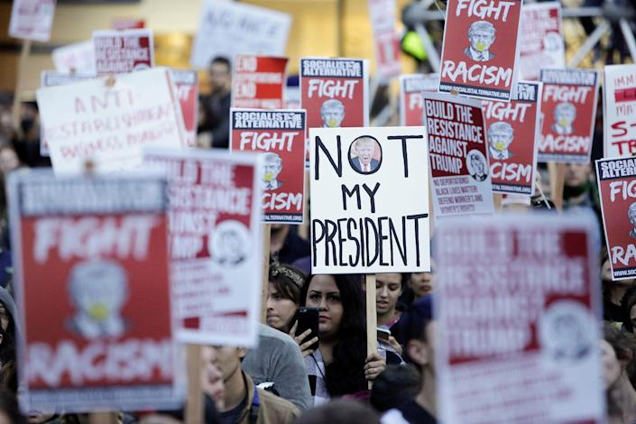 <p>People gather in protest to the election of Republican Donald Trump as the president of the United States in Seattle, Washington, U.S. November 9, 2016. (REUTERS/Jason Redmond) </p>