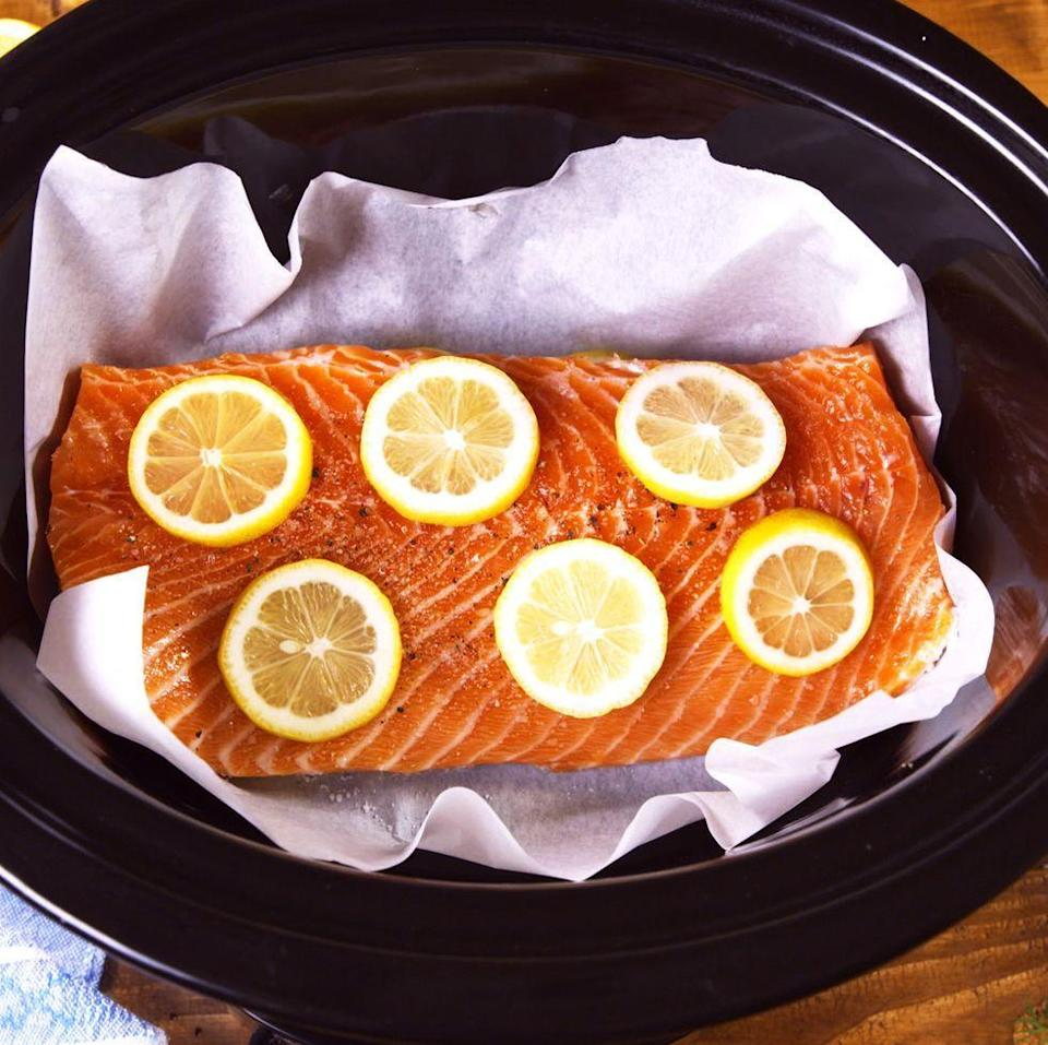 """<p>Think of this recipe as a base for all future slow cooked fish recipes. Feel free to switch up the citrus you use, or lose it all together! You could make a bed of sliced onions or leeks instead, or throw in some aromatics like rosemary or thyme. Swap out lemon juice and stock for white wine and melted butter. Do you!</p><p>Get the <a href=""""https://www.delish.com/uk/cooking/recipes/a30712008/slow-cooker-salmon-recipe/"""" rel=""""nofollow noopener"""" target=""""_blank"""" data-ylk=""""slk:Slow Cooker Salmon"""" class=""""link rapid-noclick-resp"""">Slow Cooker Salmon</a> recipe.</p>"""