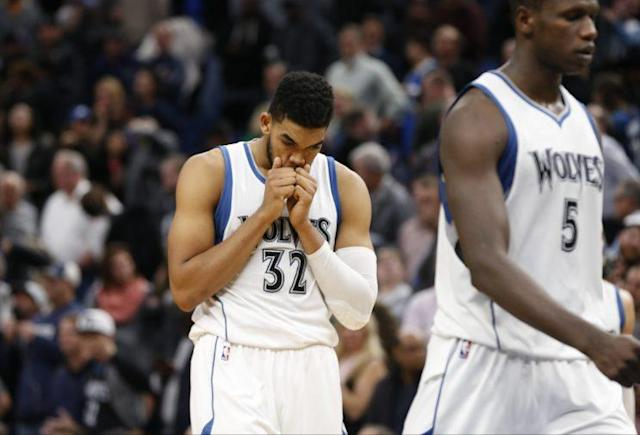"""<a class=""""link rapid-noclick-resp"""" href=""""/nba/players/5432/"""" data-ylk=""""slk:Karl-Anthony Towns"""">Karl-Anthony Towns</a> reacts to another disappointing Timberwolves loss. (Associated Press)"""