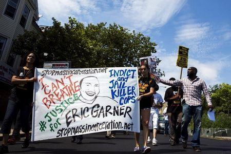 Demonstrators protest as they march to the location where Eric Garner was killed on the one year anniversary of his death in New York, July 17, 2015. REUTERS/Lucas Jackson