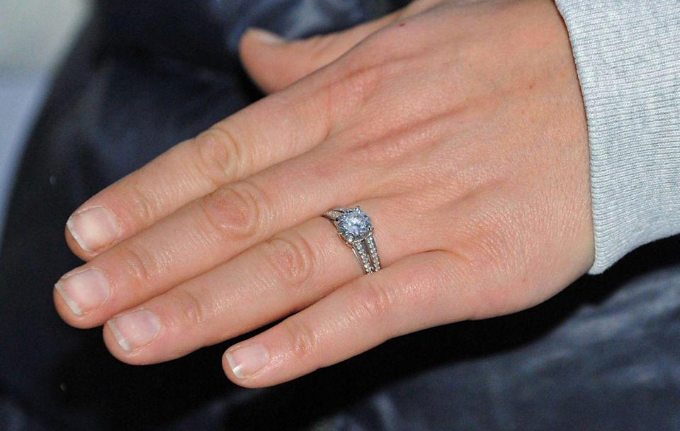 <p>Zara Tindall's engagement ring features a double pavé band and a round solitaire stone. </p>