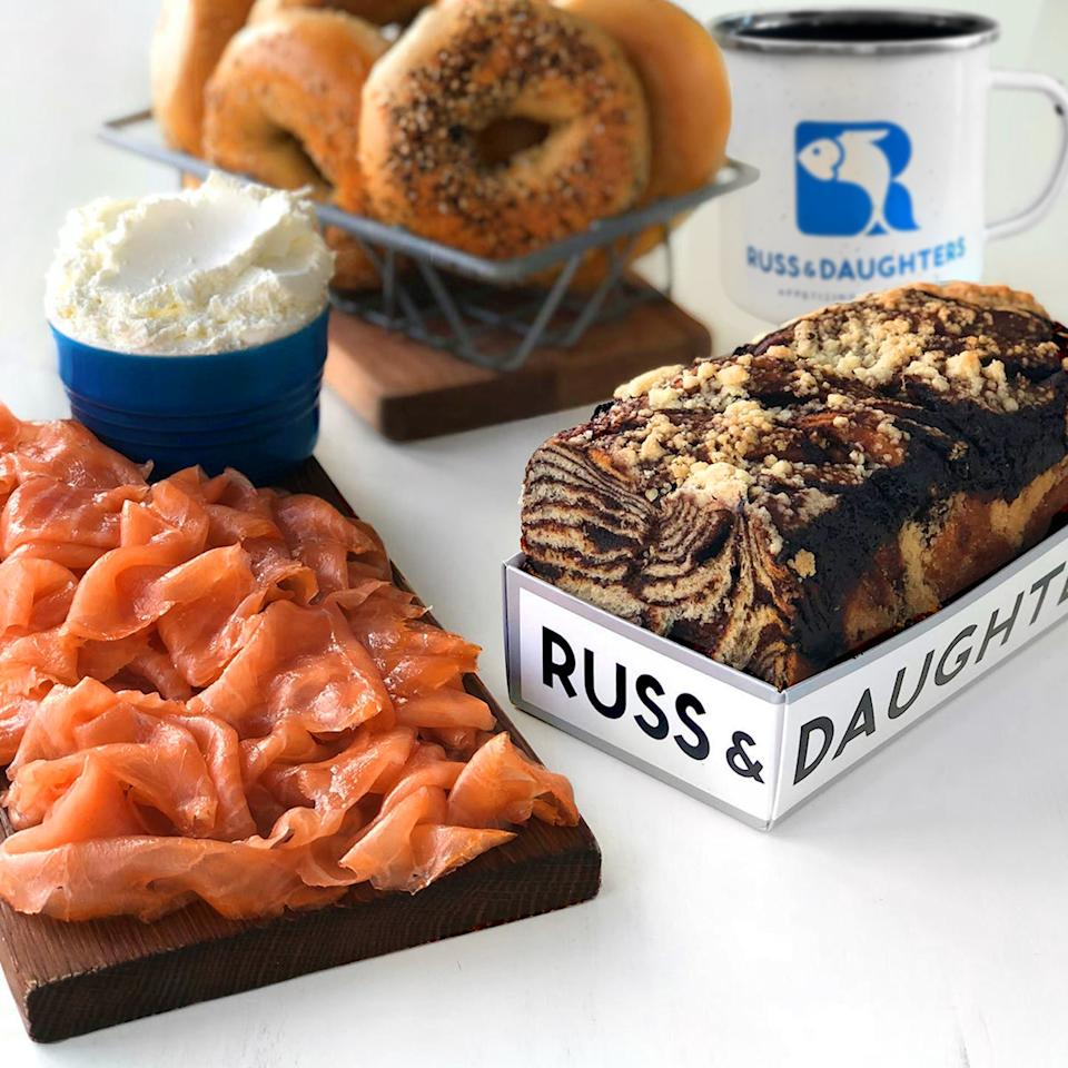 """<p><strong>Russ & Daughters</strong></p><p>goldbelly.com</p><p><strong>$179.00</strong></p><p><a href=""""https://go.redirectingat.com?id=74968X1596630&url=https%3A%2F%2Fwww.goldbelly.com%2Fruss-and-daughters%2F18810-new-york-brunch&sref=https%3A%2F%2Fwww.townandcountrymag.com%2Fleisure%2Fdining%2Fg23937264%2Fgourmet-food-gifts%2F"""" rel=""""nofollow noopener"""" target=""""_blank"""" data-ylk=""""slk:Shop Now"""" class=""""link rapid-noclick-resp"""">Shop Now</a></p><p>Give a taste of classic NYC in this special package from the famous appetizer shop Russ & Daughters, including bagels, the restaurant's beloved smoked salmon, and a chocolate babka, plus cream cheese and coffee, of course. </p><p><strong>More:</strong> <a href=""""https://www.townandcountrymag.com/leisure/dining/g34837514/new-york-city-foods-order-online/"""" rel=""""nofollow noopener"""" target=""""_blank"""" data-ylk=""""slk:Classic New York Foods to Order Online Now"""" class=""""link rapid-noclick-resp"""">Classic New York Foods to Order Online Now</a></p>"""