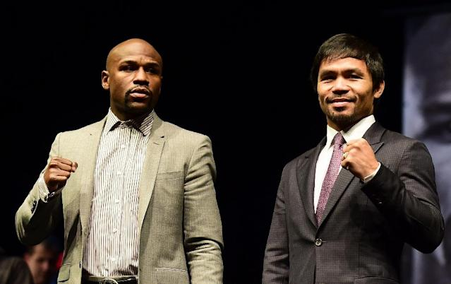 Boxers Manny Pacquiao (R) from the Philippines and Floyd Mayweather from the US pose during a press conference on March 11, 2015 in Los Angeles, California, to launch the countdown to their May 2, 2015 super-fight in Las Vegas (AFP Photo/Frederic J. Brown)