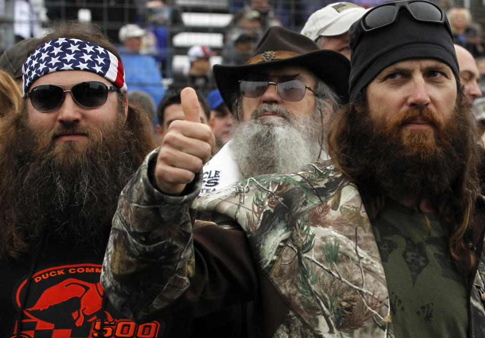 Duck Dynasty's Willie Robertson, Si Robertson and Jase Robertson before the rain delayed NASCAR Sprint Cup Series auto race at Texas Motor Speedway in Fort Worth, Texas, Sunday, April 6, 2014. (AP Photo/Mike Stone)