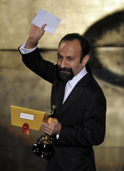 """Asghar Farhadi, of Iran, accepts the Oscar for best foreign language film for """"A Separation"""" during the 84th Academy Awards on Sunday, Feb. 26, 2012, in the Hollywood section of Los Angeles. (AP Photo/Mark J. Terrill)"""