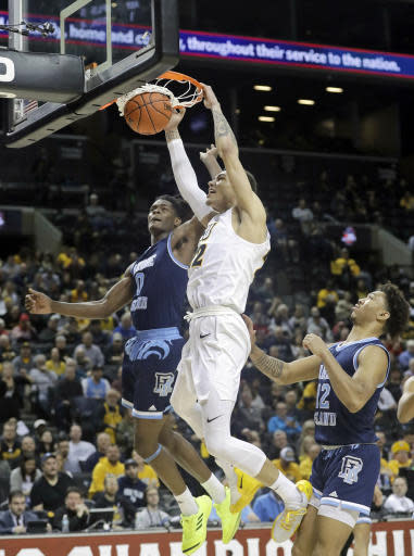 VCU's Michael Gilmore (22) dunks the ball in front of Rhode Island's Jermaine Harris (0) and Dana Tate (12) during the first half of an NCAA college basketball game in the Atlantic 10 conference tournament Friday, March 15, 2019, in New York. (AP Photo/Frank Franklin II)