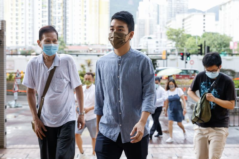 Pro-democracy activist Tat Cheng Tat-hung (C), one of the 47 pro-democracy activists charged with conspiracy to commit subversion under the national security law, arrives West Kowloon Magistrates's Courts building, in Hong Kong