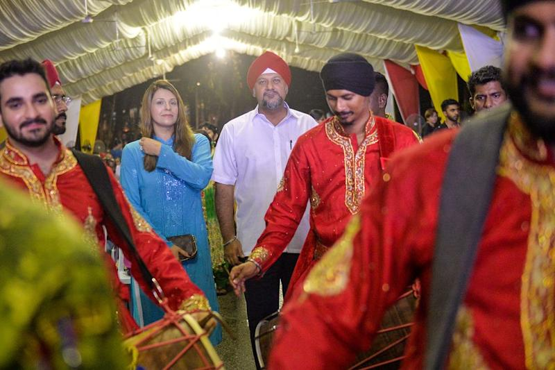 Multimedia and Communication Minister Gobind Singh Deo and wife Sangeeta Kaur arrive at the National Vaisakhi celebration open house in Kuala Lumpur, May 26, 2019. — Pix by Mukhriz Hazim