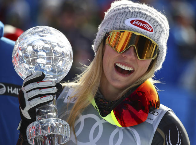 United States's Mikaela Shiffrin holds the women's World Cup slalom discipline trophy, at the alpine ski World Cup finals in Are, Sweden, Saturday, March 17, 2018. (AP Photo/Marco Trovati)