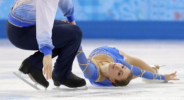Andrea Davidovich and Evgeni Krasnopolski of Israel compete in the pairs free skate figure skating competition at the Iceberg Skating Palace during the 2014 Winter Olympics, Wednesday, Feb. 12, 2014, in Sochi, Russia. (AP Photo/Vadim Ghirda)