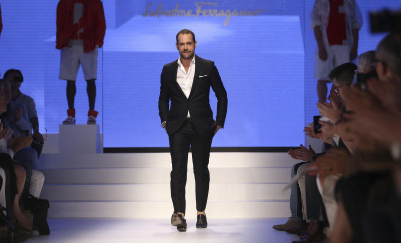 Creative director Massimiliano Giornetti takes the catwalk at the end of the Salvatore Ferragamo men's Spring-Summer 2014 fashion show, part of the Milan Fashion Week, unveiled in Milan, Italy, Sunday, June 23, 2013. (AP Photo/Luca Bruno)