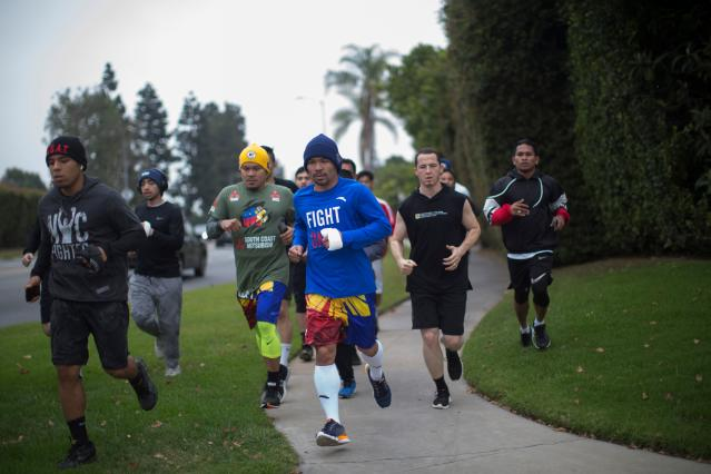 Manny Pacquiao (C) jogs in the morning with fans and friends in Los Angeles on June 20, 2019. (Apu Gomes/AFP/Getty Images)