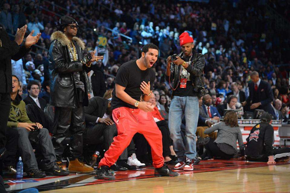 <p>The rappers were spied courtside at NBA All-Star Weekend in 2013 rocking leather bottoms. 2 Chainz kept it demure with a black pair, while Drake chose to stand out in bright red. <i>(Photo: Getty Images)</i></p>