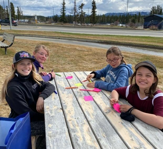 Members of the Kindness Club making positive sticky notes.