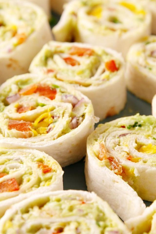 "<p>These chicken <a href=""https://www.delish.com/uk/cooking/recipes/a30323665/greek-stuffed-avocado-recipe/"" target=""_blank"">avocado</a> salad pinwheels double as a nutritious lunch and an adorable party appetiser.</p><p>Get <a href=""https://www.delish.com/uk/cooking/recipes/a33257651/chicken-avocado-roll-ups/"" target=""_blank"">Chicken & Avocado Roll Ups</a> recipe.</p>"