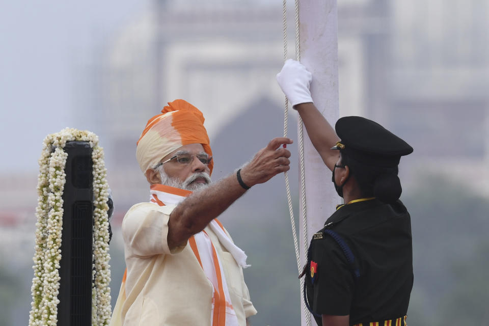 India's Prime Minister Narendra Modi (L) unfurls the tricolour during a ceremony to celebrate Inda's 74th Independence Day in New Delhi on August 15, 2020. (Photo by PRAKASH SINGH/AFP via Getty Images)