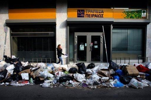 Greece launches debt buyback as Spain bank cash agreed
