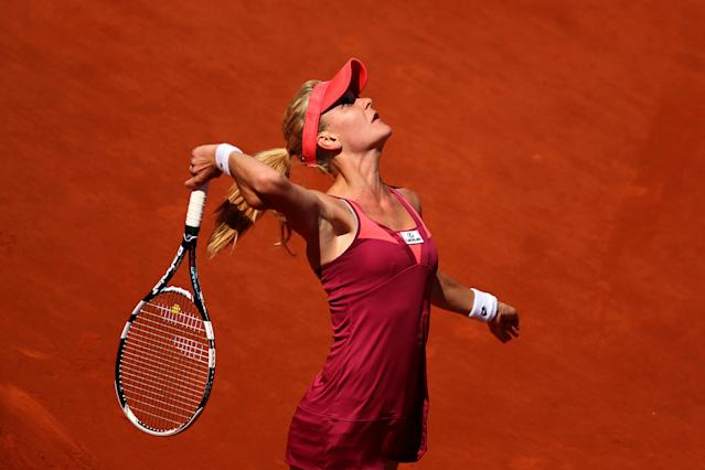 PARIS, FRANCE - JUNE 04: Agnieszka Radwanska of Poland serves during her Women's Singles quarter-final match against Sara Errani of Italy on day ten of the French Open at Roland Garros on June 4, 2013 in Paris, France. (Photo by Clive Brunskill/Getty Images)