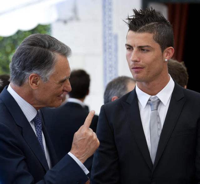 Portugal's President Anibal Cavaco Silva (L) speaks to Portugal's national football team player Cristiano Ronaldo during a meeting at the Belem Palace in Lisbon on June 4, 2012, before the departure of Portugal's national team players for Poznan to take part in the Euro 2012 football championship, which will take place in Poland and Ukraine from June 8 to July 1. AFP PHOTO/ PEDRO NUNESPEDRO NUNES/AFP/GettyImages