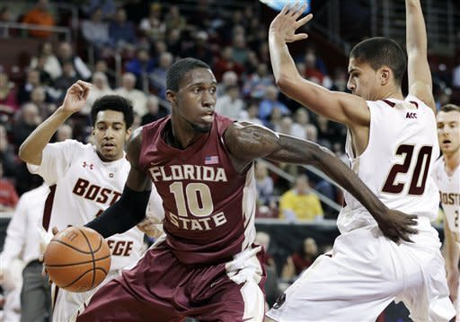 Florida State's Okaro White (10) drives against Boston College's Lonnie Jackson (20) and Jordan Daniels, rear left, during the first half of an NCAA college basketball game in Boston on Wednesday, Feb. 8, 2012. (AP Photo/Elise Amendola)