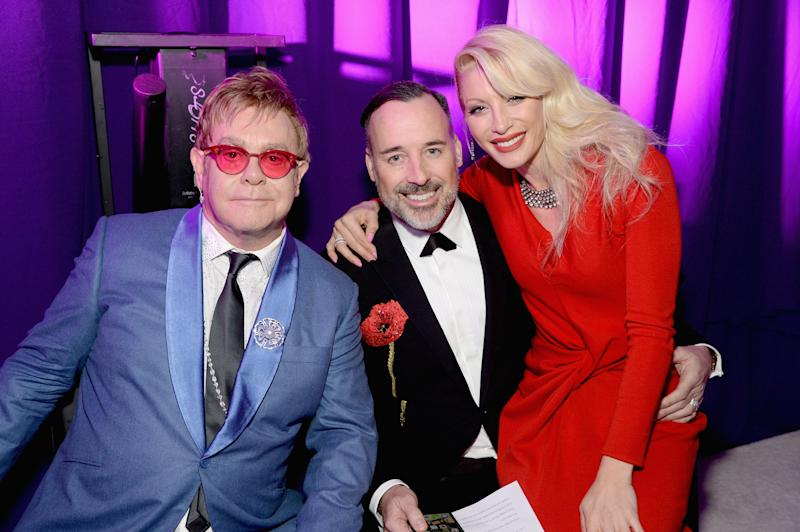 LOS ANGELES, CA - FEBRUARY 22: Singer songwriters Sir Elton John (L), Dani Behr (R) and David Furnish (C) attend the 23rd Annual Elton John AIDS Foundation Academy Awards Viewing Party on February 22, 2015 in Los Angeles, California. (Photo by Michael Kovac/Getty Images for EJAF)