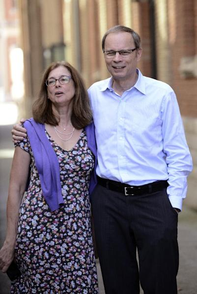 Laureate of the 2014 Nobel Prize in Economics, French economist Jean Tirole and his wife Nathalie are seen at the Toulouse School of Economics (TSE) on October 13, 2014 in Toulouse (AFP Photo/Remy Gabalda)