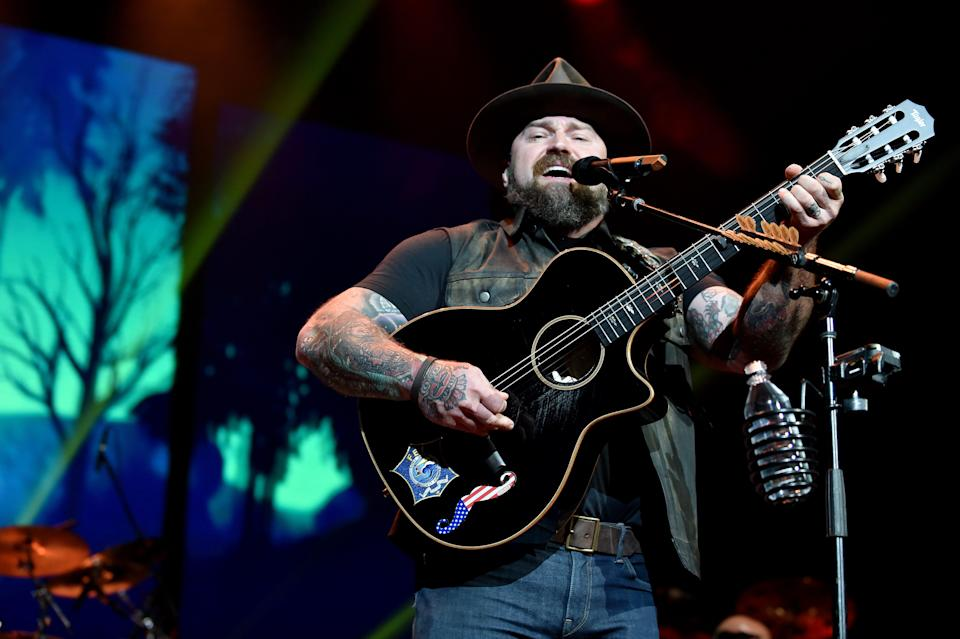 Zac Brown Band pauses their tour after the lead singer tests positive for COVID-19.