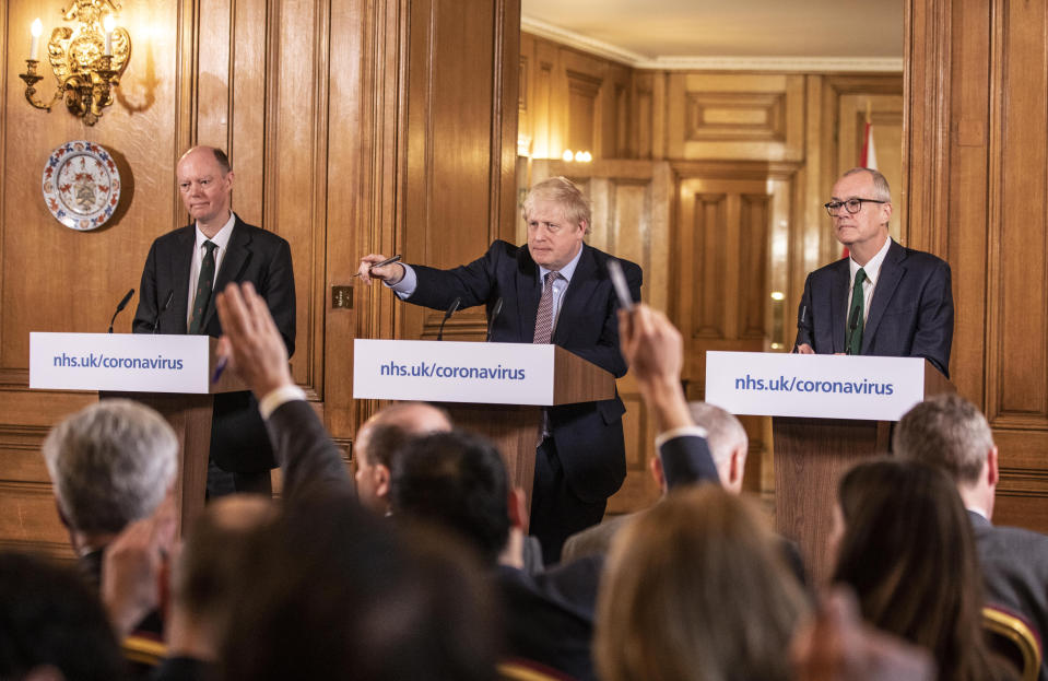 Chief Medical Officer for England Chris Whitty (left) and Chief Scientific Adviser Sir Patrick Vallance stand with Prime Minister Boris Johnson during a media briefing in Downing Street, London, on Coronavirus (COVID-19) after the government�s COBRA meeting. Picture date: Monday March 16, 2020. See PA story HEALTH Coronavirus. Photo credit should read: Richard Pohle/The Times /PA Wire
