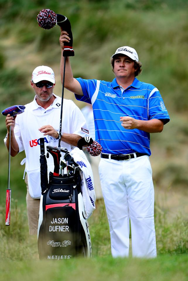 ARDMORE, PA - JUNE 16: Jason Dufner of the United States pulls a club from his bag on the 18th tee alongside caddie Kevin Baile  during the final round of the 113th U.S. Open at Merion Golf Club on June 16, 2013 in Ardmore, Pennsylvania.  (Photo by David Cannon/Getty Images)