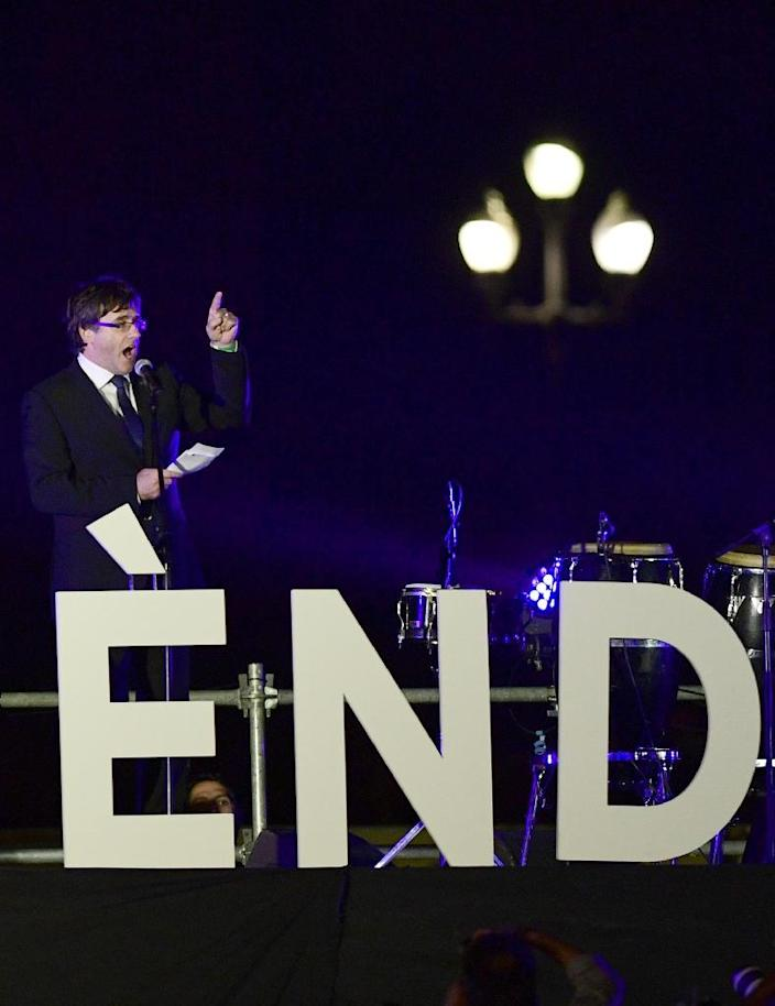 """Is it the end, or the beginning? Catalan president Carles Puigdemont spoke at a closing rally on a stage featuring the word """"Referendum"""" in huge letters (AFP Photo/PIERRE-PHILIPPE MARCOU)"""