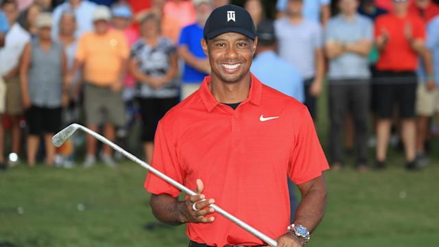 Jack Nicklaus and NBA Hall of Famer Magic Johnson were among the greats to congratulate Tiger Woods on his success.