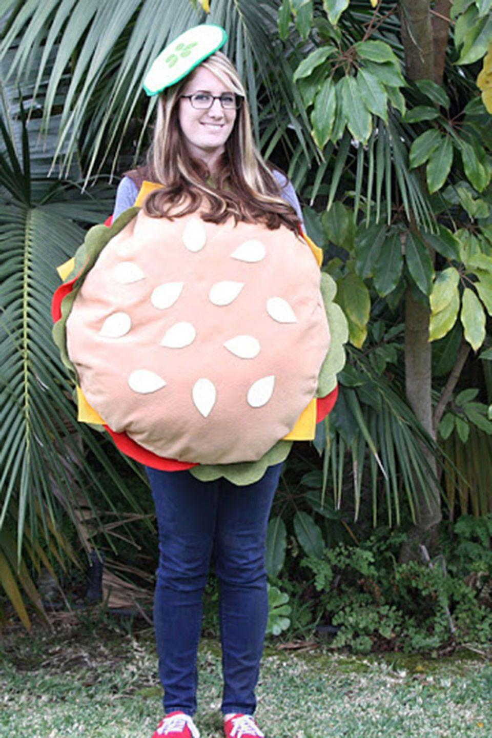 """<p>We're partial to the pickle beret, but you can customize this easy Halloween costume with your toppings of choice. </p><p><strong>Get the tutorial at <a href=""""http://www.pleasenotepaper.com/2013/10/diy-no-sew-burger-costume.html"""" rel=""""nofollow noopener"""" target=""""_blank"""" data-ylk=""""slk:Please Note Paper"""" class=""""link rapid-noclick-resp"""">Please Note Paper</a>.</strong></p><p><a class=""""link rapid-noclick-resp"""" href=""""https://www.amazon.com/Tan-Acrylic-Felt-72-yard/dp/B01ENI8RN6/ref=sr_1_2?tag=syn-yahoo-20&ascsubtag=%5Bartid%7C10050.g.4571%5Bsrc%7Cyahoo-us"""" rel=""""nofollow noopener"""" target=""""_blank"""" data-ylk=""""slk:SHOP TAN FELT""""><strong>SHOP TAN FELT</strong></a></p>"""